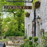 Coach and Horses sign on the front of the pub