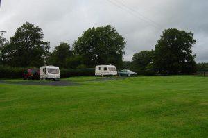 Two caravans in a field